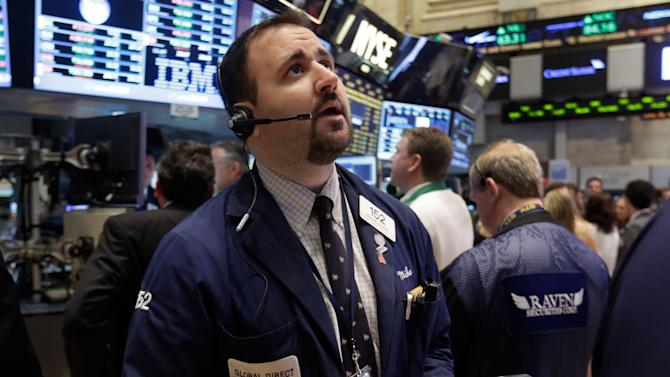 Trader Michael Mozian works on the floor of the New York Stock Exchange Monday, June 10, 2013. Asian stocks rebounded Friday June 14, 2013 from Tokyo's sharp decline after investors were encouraged by positive U.S. economic news. (AP Photo/Richard Drew)