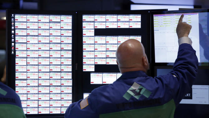 Specialist Matthew Cheslock works at his post on the floor of the New York Stock Exchange Monday, April 29, 2013.  A pair of encouraging economic reports helped propel the stock market up in early trading on Monday. (AP Photo/Richard Drew)