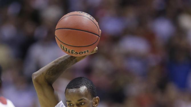 Louisville guard Russ Smith (2) reacts during the second half of a regional semifinal against Oregon in the NCAA college basketball tournament, Friday, March 29, 2013, in Indianapolis. Louisville won 77-69. (AP Photo/Michael Conroy)