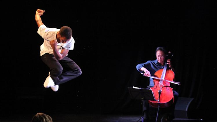 This April 2, 2013 photo released by New York City Center shows Lil Buck, left, performing with Yo-Yo Ma, at Poisson Rouge nightclub in New York. (AP Photo/New York City Center, Erin Baiano)