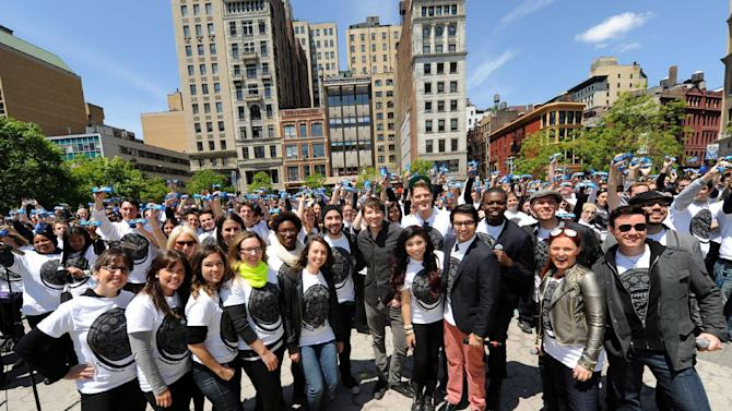IMAGE DISTRIBUTED FOR OREO - Singer-songwriter Owl City (A.K.A. Adam Young), center in black shirt, joins 500 a cappella singers, including famed vocal quintet Pentatonix, in New York's Union Square, Tuesday, May 14, 2013, for a group sing-a-long of the OREO Wonderfilled anthem to kick off the brand's new campaign. (Photo by Diane Bondareff/Invision for OREO/AP Images)