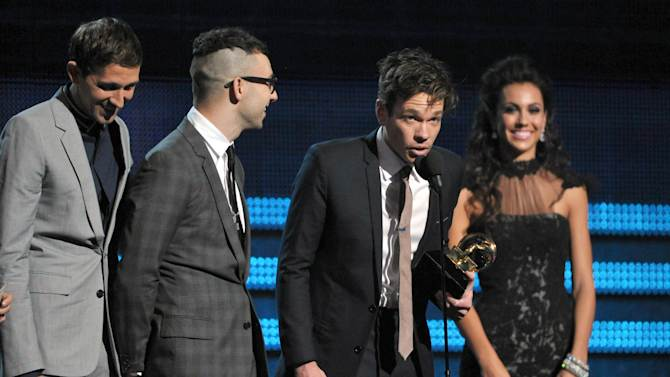 """members of fun., from left, Nate Ruess, Andrew Dost and Jack Antonoff accept the award for song of the year for """"We Are Young"""" at the 55th annual Grammy Awards on Sunday, Feb. 10, 2013, in Los Angeles. (Photo by John Shearer/Invision/AP)"""