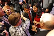 Louisiana Governor Bobby Jindal and his wife Supriya greet supporters during his re-election victory party at the Renaissance Hotel in Baton Rouge on Saturday, Oct. 22, 2011. (AP Photo/The Times-Picayune, Michael DeMocker)