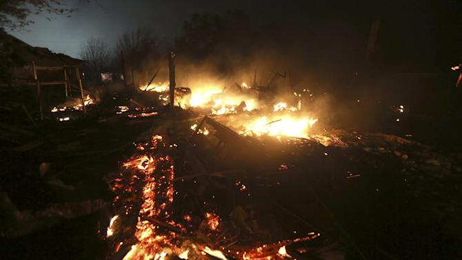 The remains of a home burn early Thursday morning, April 18, 2013, after a fertilizer plant exploded Wednesday night in West, Texas. The massive explosion killed as many as 15 people and injured more than 160, shaking the ground with the strength of a small earthquake and leveling homes and businesses for blocks in every direction. (AP Photo/LM Otero)