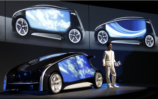 A presenter explains about Toyota Fun-Vii in Tokyo Monday, Nov. 28, 2011. Toyota Motor Corp. unveiled the futuristic concept car resembling a giant smartphone to demonstrate how Japan's top automaker