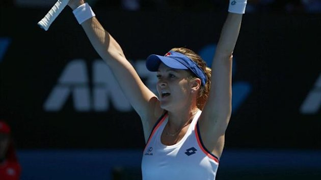 Agnieszka Radwanska of Poland celebrates defeating Victoria Azarenka of Belarus (Reuters)