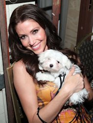 Shannon Elizabeth poses with a furry friend backstage at the 19th Annual Race to Erase MS held at the Hyatt Regency Century Plaza in Century City, Calif., on May 18, 2012 -- Getty Images