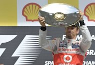 McLaren Mercedes' driver Jenson Button celebrates on the podium at the Spa-Francorchamps circuit in Spa during the Belgium Formula One Grand Prix. Button claimed his second win this year and 14th of his career when he drove to a comprehensive victory in an incident and accident-packed Belgian Grand Prix