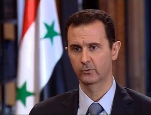 An image grab taken from a video uploaded to YouTube by the Syrian Presidency on October 4, 2013, shows President Bashar al-Assad speaking during an interview with Turkish media in Damascus