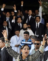 "A supporter of Pakistan's Prime Minister Yousuf Raza Gilani demonstrates against the Supreme Court as anti-government lawyers amass behind her in Islamabad. The court disqualified Gilani from office on Tuesday in a stunning move likened to a ""judicial coup"" that threw the country into fresh turmoil"
