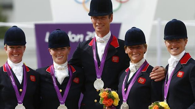 Britain's Nicola Wilson, Zara Phillips, William Fox-Pitt, Mary King and Kristina Cook pose after receiving their silver medals in the Eventing Team Jumping equestrian event victory ceremony at London 2012 (Reuters)