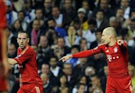 Bayern Munich's Dutch midfielder Arjen Robben (right) talks to French midfielder Franck Ribery (left) during the UEFA Champions League second leg semi-final football match against Real Madrid in April. Robben said Friday he wants to turn the clock back and rediscover the relationship he had with teammate Ribery before last April's bust-up between the pair