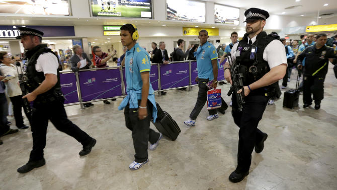 Members of the Brazilian Olympic soccer team arrive at Heathrow Airport Tuesday, July 17, 2012 as London prepares for the 2012 Summer Olympics. Opening Ceremonies for the London Olympics will be held Friday July 27, 2012. (AP Photo/Charlie Riedel)