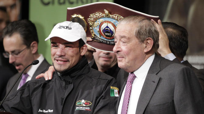 Juan Marquez speaks during a press conference after his 6th round knockout victory over Manny Pacquiao, Saturday, Dec. 8, 2012, at The MGM Grand Garden Arena in Las Vegas. (AP Photo/Eric Jamison)