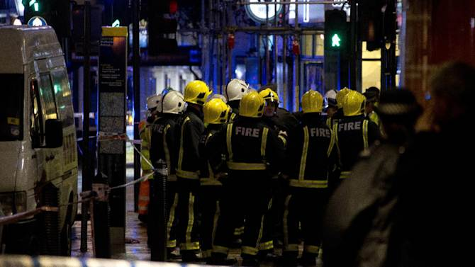 """Firemen confer at the scene following an incident at the Apollo Theatre, in London's Shaftesbury Avenue, Thursday evening, Dec. 19, 2013, during a performance at the height of the Christmas season, with police saying there were """"a number"""" of casualties. It wasn't immediately clear if the roof, ceiling or balcony had collapsed during a performance. Police said they """"are aware of a number of casualties,"""" but had no further details. (AP Photo by Joel Ryan, Invision)"""