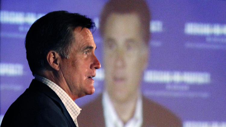 """Republican presidential candidate, former Massachusetts Gov. Mitt Romney speaks at an """"Americans for Prosperity"""" campaign event in Troy, Mich., Saturday, Feb. 25, 2012. (AP Photo/Gerald Herbert)"""