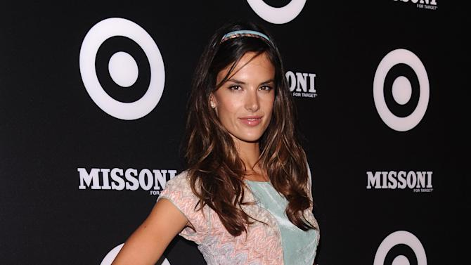 In this Sept. 7, 2011 photo, Alessandra Ambrosio attends the Missoni For Target event, celebrating the Missoni for Target pop up store, in New York.    Target drummed up so much buzz for its exclusive, limited-time line by high-end Italian designer Missoni that its web site was down for most of the day last Tuesday when the collection was launched, which angered some customers. Now, more than a week later, some shoppers who bought the Missoni By Target line of clothes, housewares and other doodads are saying they'll never shop at the retailer again after finding out their online orders have been delayed _ or worse, canceled.   (AP Photo/Peter Kramer)