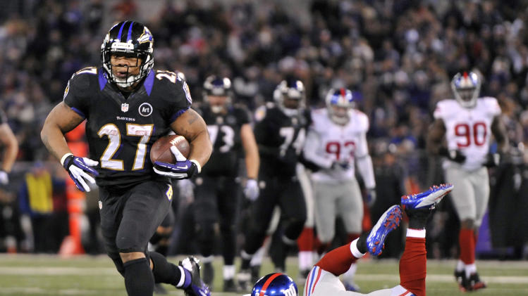 Baltimore Ravens running back Ray Rice, left, rushes past New York Giants strong safety Stevie Brown for a touchdown in the first half of an NFL football game in Baltimore, Sunday, Dec. 23, 2012. (AP Photo/Gail Burton)