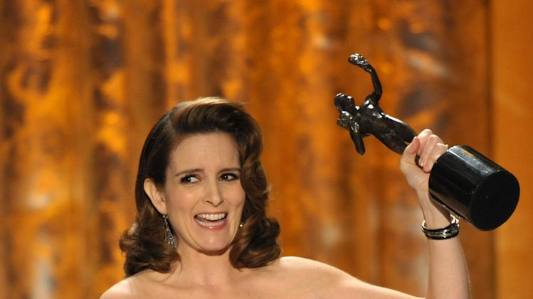 "Tina Fey accepts the award for outstanding female actor in a comedy series for ""30 Rock"" at the 19th Annual Screen Actors Guild Awards at the Shrine Auditorium in Los Angeles on Sunday Jan. 27, 2013. (Photo by John Shearer/Invision/AP)"