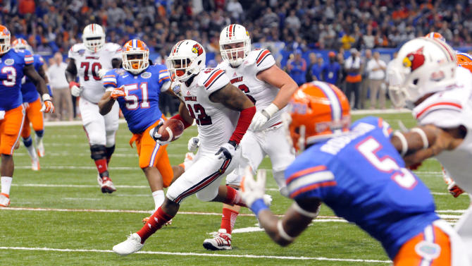 The University of Louisville's Stephan Robinson carries the ball during the 2013 Allstate Sugar Bowl at the Mercedes-Benz Superdome in New Orleans on Jan. 2, 2013. (Cheryl Gerber/AP Images for Allstate)