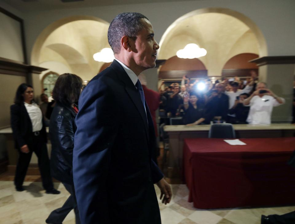 President Barack Obama walks the corridors of Bellagio Hotel and Casino before speaking to employees during an unscheduled visit after a campaign event nearby on Wednesday, Oct. 24, 2012, in Las Vegas. (AP Photo/Pablo Martinez Monsivais)