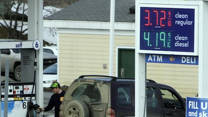 In this Feb. 16, 2012 photo, a customer fills up at an Irving Oil gas station, in Berlin, Vt. Gasoline prices have never been higher at this time of year. At $3.51 a gallon, gas is up 23 percent since Jan. 1. And experts say motorists could pay a record $4.25 a gallon by late April. (AP Photo/Toby Talbot)