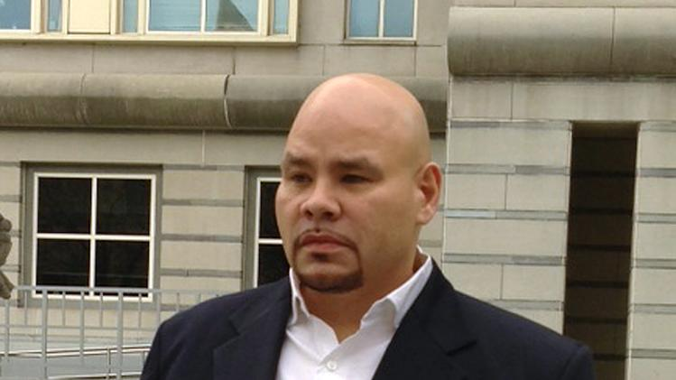 """Fat Joe,"" whose real name is Joseph Cartagena, leaves court in Newark N.J., Thursday, Dec. 20, 2012. The rap star faces up to two years in prison after pleading guilty in federal court to failing to pay taxes on nearly $3 million in income over two years. (AP Photo/Samantha Henry)"