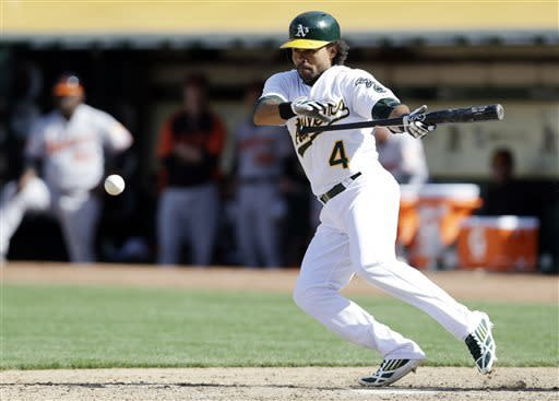 A's rally late, beat Orioles in 10th on error
