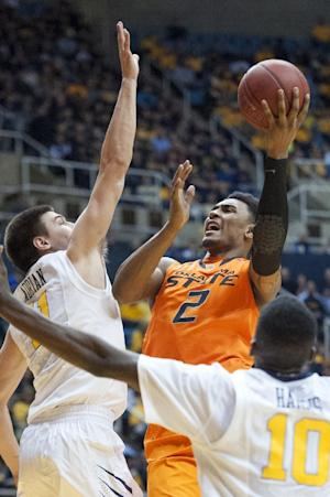 No. 11 Oklahoma St beats West Virginia 73-72