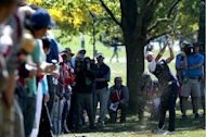 Ian Poulter of Europe hits a shot on the 12th hole during the Ryder Cup Singles Matches on Sunday. Europe on Monday revelled in its golfers&#39; last-gasp Ryder Cup win over the United States, praising a gutsy fight-back from a seemingly hopeless position, as their opponents pondered their defeat