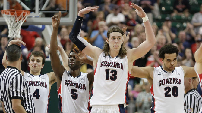 Gonzaga players from left, Kevin Pangos (4), Gary Bell Jr. (5), Kelly Olynyk (13) and Elias Harris (20) react as they come off the court near the end of the game against Saint Mary's during the West Coast Conference tournament championship NCAA college basketball game, Monday, March 11, 2013, in Las Vegas. Gonzaga won 65-51.  (AP Photo/Julie Jacobson)