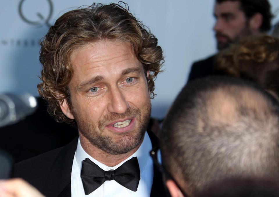 Gerard Butler arrives for the amfAR Cinema Against AIDS benefit at the Hotel du Cap-Eden-Roc, during the 65th Cannes film festival, in Cap d'Antibes, southern France, Thursday, May 24, 2012. (AP Photo/Joel Ryan)