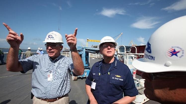 U.S. Coast Guard Commandant Adm. Robert J. Papp Jr., center, is given a tour of the new Coast Guard National Security Cutter Stratton (WMSL 752) by Ingalls Shipbuilding Program Manager Mike Duthu, left, and Ingalls Shipbuilding President Irwin F. Edenzon, right, Friday July, 29, 2011, in the shipyard in Pascagoula, Miss. Papp said he envisions fully modern ships built in this century that don't require constant heavy maintenance. But he said he knows significant roadblocks remain. (AP Photo/Kerry Maloney)