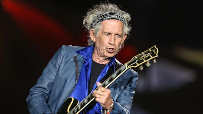 "FILE - In this May 24, 2015 file photo, Keith Richards performs at The Rolling Stones Zip Code Tour opening night at Petco Park in San Diego. Richards doesn't keep a list of the Top 10 Rolling Stones albums. But he's happy to place ""Sticky Fingers,"" now being re-released in a deluxe edition, near the very top. The album catches the Stones in transition, with Mick Taylor stepping fully into his role as the late Brian Jones' replacement. The Stones also moved beyond their comfort zone, recording several songs at the famed Muscle Shoals Sound Studio in rural Alabama rather than in their usual London haunts. (Photo by Rich Fury/Invision/AP, File)"