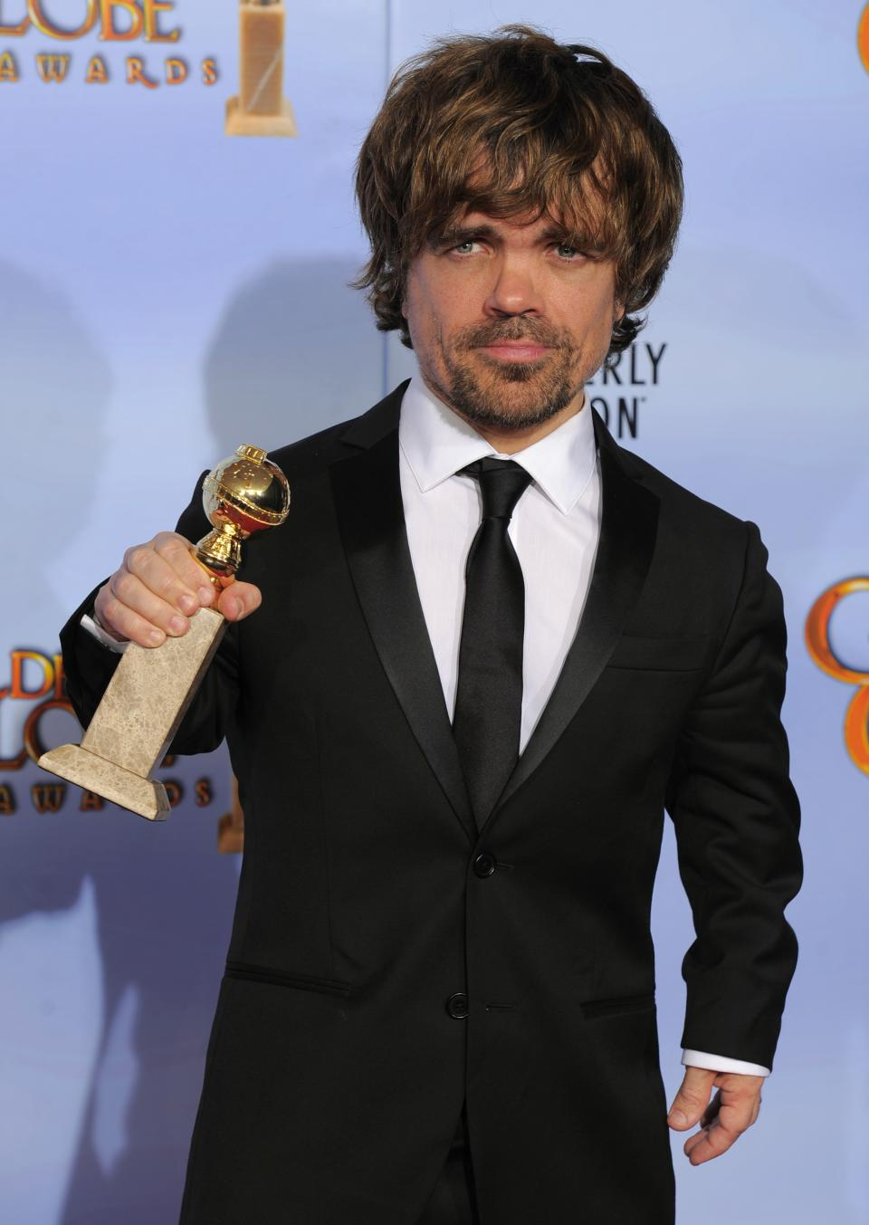 "Actor Peter Dinklage poses backstage with the award for Best Supporting Actor in a Series, Mini Series or TV Movie for ""Game of Thrones"" during the 69th Annual Golden Globe Awards Sunday, Jan. 15, 2012, in Los Angeles. (AP Photo/Mark J. Terrill)"