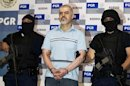 Drug cartel leader Eduardo Arellano Felix is presented to the media in Mexico City