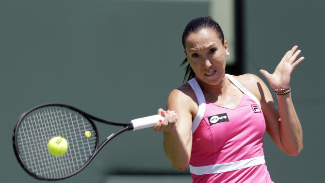 Jelena Jankovic, of Serbia, returns to Maria Sharapova, of Russia, during the semifinals of the Sony Open tennis tournament in Key Biscayne, Fla., Thursday, March 28, 2013. (AP Photo/Alan Diaz)