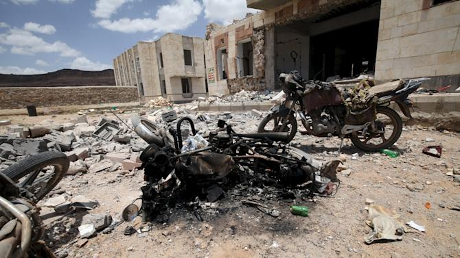 Wreckage of motorcycles are seen near a building damaged by a Saudi-led air strike near Sanaa