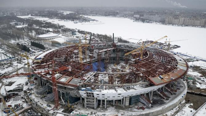 FILE - In this Sunday, Feb. 15, 2015, file aerial view of the the construction site of the new Zenit Stadium  which will host matches of the 2018 World Cup in St.Petersburg, Russia.  Swiss federal prosecutors opened criminal proceedings related to the awarding of the 2018 and 2022 World Cups, throwing FIFA deeper into crisis only hours after seven soccer officials were arrested and 14 indicted Wednesday in a separate U.S. corruption probe.  (AP Photo/Dmitry Lovetsky, file)