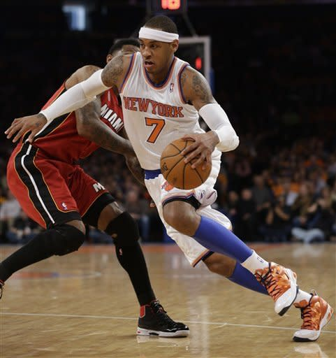 Heat rally past Knicks, win 14th straight