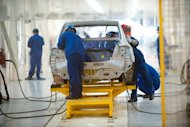 Workers are seen assembling a car in the Chang'an automobile factory in Beijing, in August. Chinese exports rose 9.9 percent in September year-on-year to a record monthly high, the government said on Saturday, but analysts warned the performance was unsustainable given the weak global outlook