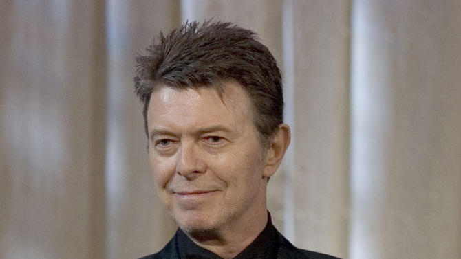 """FILE - David Bowie attends an awards show in this June 5, 2007 file photo taken in New York. The English singer announced Tuesday,  Jan. 8, 2013 his 66th birthday, that he has released his first song in 10 years titled """"Where Are We Now?"""" A new album, """"The Next Day,"""" will be out March 11 and 12 in the United Kingdom and the United States, respectively. (AP Photo/Stephen Chernin)"""
