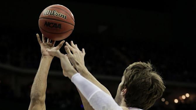North Carolina forward James Michael McAdoo (43) shoots under pressure from Kansas center Jeff Withey (5) during the first half of a third-round game in the NCAA college basketball tournament Sunday, March 24, 2013, in Kansas City, Mo. (AP Photo/Charlie Riedel)