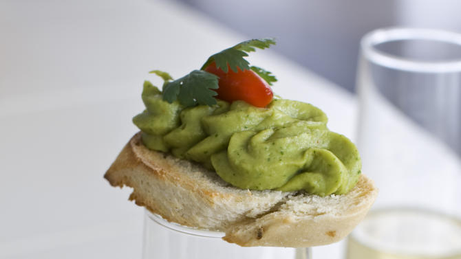 n this image taken on Monday, November 26, 2012, Christmas sangria and spring pea guacamole are shown in Concord, N.H. (AP Photo/Matthew Mead)