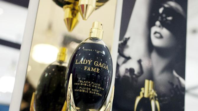 In this Aug. 23, 2012, photo, Fame perfume from the Lady Gaga collection is displayed at a Lord & Taylor department store in New York. Celebrities have long dabbled in design, but with the growth of TV shows and websites that follow everything celebrities say, wear and do, interest in their clothing lines has risen in recent years. North America revenue from celebrity clothing lines, excluding merchandise linked to athletes, rose 6 percent last year to an historic peak of $7.58 billion in 2011, according to the latest figures available by The Licensing Letter, an industry trade. That's on top of a nearly 5 percent increase in 2010.  (AP Photo/Mark Lennihan)