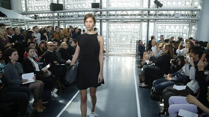 A model presents a creation for French fashion designer Christine Phung's Spring-Summer 2015 ready-to-wear fashion collection presented in Paris, France, Tuesday, Sept. 23, 2014. (AP Photo/Michel Euler)