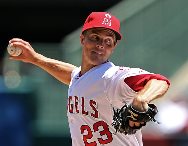 File- This July 19, 2012 file photo shows Los Angeles Angels starter Zack Greinke pitching to the Tampa Bay Rays in the second inning of a baseball game in Anaheim, Calif. A person familiar with the negotiations tells The Associated Press that the Los Angeles Dodgers are trying to close a deal with Greinke worth $147 million over six years. (AP Photo/Reed Saxon, File)