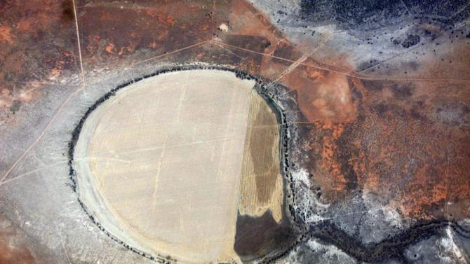 Cultivated agricultural ground can be seen amongst drought affected farmland in south Australia