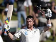 New Zealand's Brendon McCullum signals his 100 against India during the second innings on day three of the second international test cricket match at the Basin Reserve in Wellington, February 16, 2014. REUTERS/Anthony Phelps