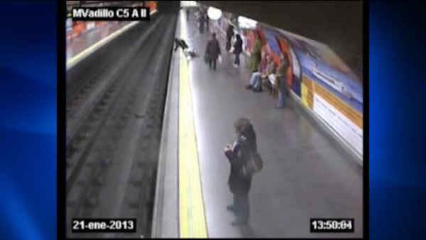 Spain subway track fall rescue caught on tape
